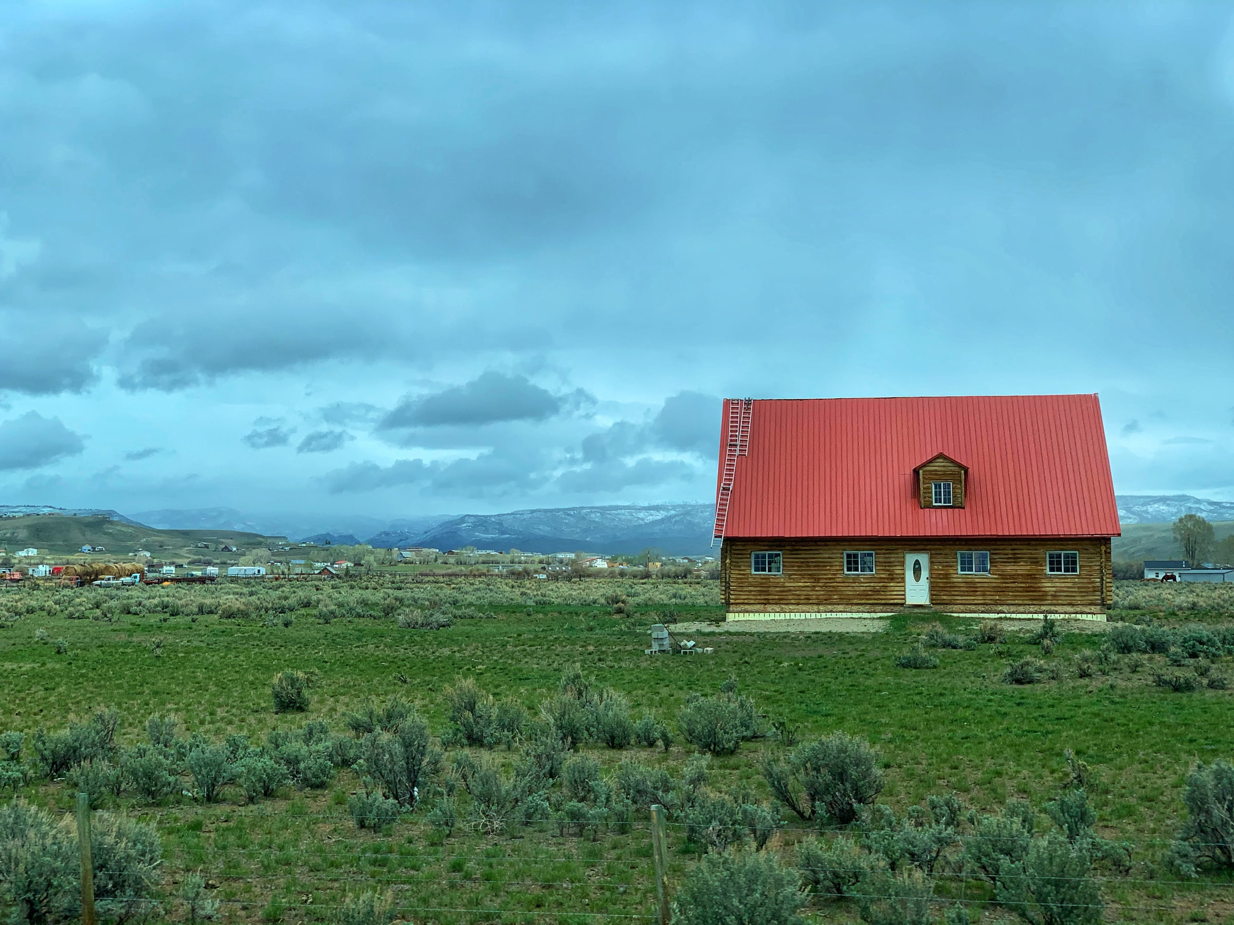 image of red roofed house in wyoming